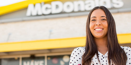 Woman Smiling In Front of a McDonald's Restaurant